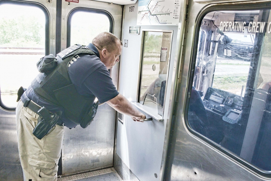 A member of TSA VIPR team peers out of a Greater Cleveland RTA train after a report of a suspicious item near the tracks.