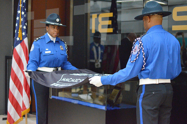 The TSA Color Guard at IAD unveils the artifact during the memorial, Thursday, Sept. 1, 2016, at the IAD airport.