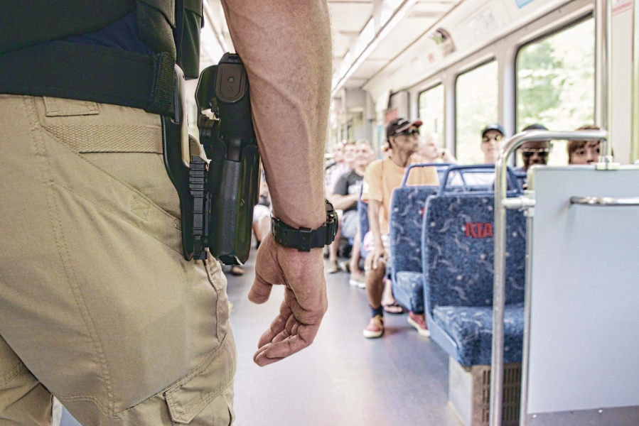 An armed VIPR officer rides a Greater Cleveland Regional Transit Authority train during the convention. TSA VIPR officers from Chicago, Detroit and throughout the region assisted in the security effort.
