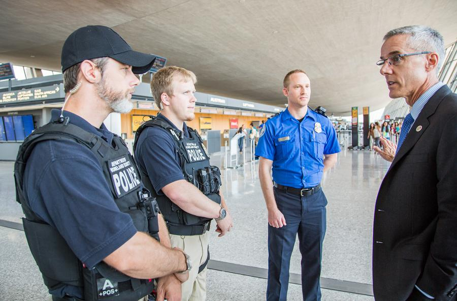 Administrator Peter Neffenger meets with TSA employees during an airport visit.