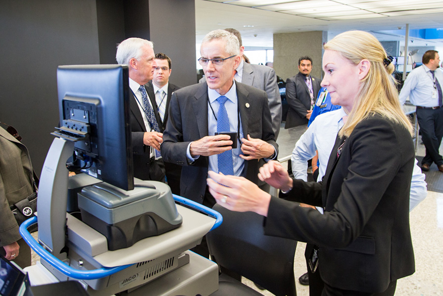 Administrator Peter Neffenger receives an overview of TSA's credential authentication technology during an airport visit.