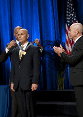 Secretary of Homeland Security Jeh Johnson and Deputy Secretary of Homeland Security Alejandro Mayorkas presented the Secretary's Exceptional Service Gold Medal 2016 to Brett Gunter