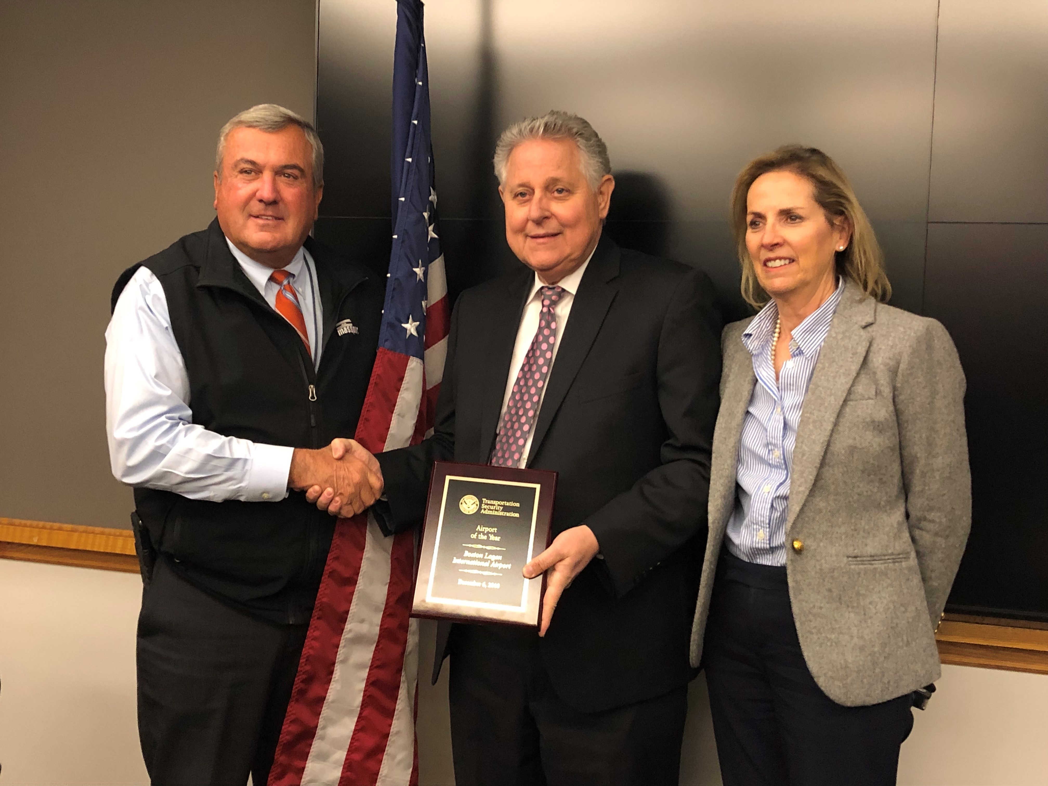 MassPort Aviation Director Ed Freni (left) congratulates TSA's Massachusetts Federal Security Director Bob Allison and TSA Deputy Federal Security Director Marcy Donnelly after Boston Logan International Airport was awarded TSA's 2018 Airport of the Year