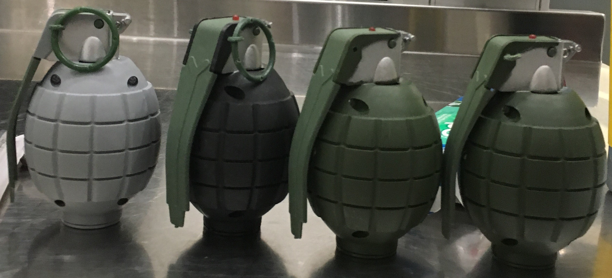 These 4 replica grenades were discovered in a carry-on bag at the Baltimore-Washington International Airport (BWI).