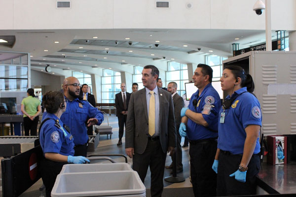 From left, Transportation Security Officer April Jenkins, Lead Transportation Security Officers Steven Madrid and Jesus Lopez, and Transportation Security Officer Sally Aguilar with Acting Deputy Secretary Pekoske