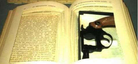 A gun in a hollowed out book was discovered at Honolulu (HNL).