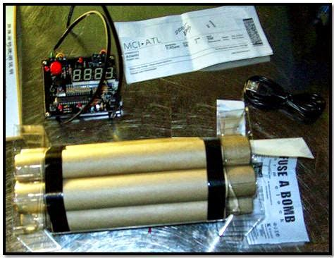 A novelty alarm clock resembling an explosive device was discovered in a carry-on bag at Kansas City (MCI).