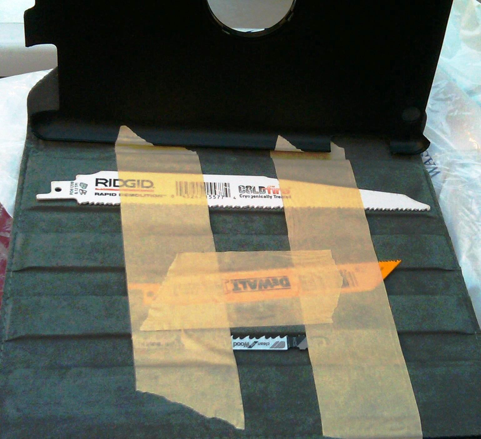 Three saw blades were discovered taped to the inside of an iPad case at Washington Dulles (IAD).