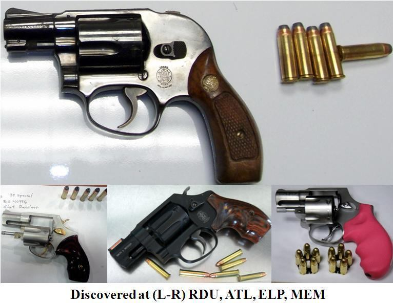 Four loaded revolvers.