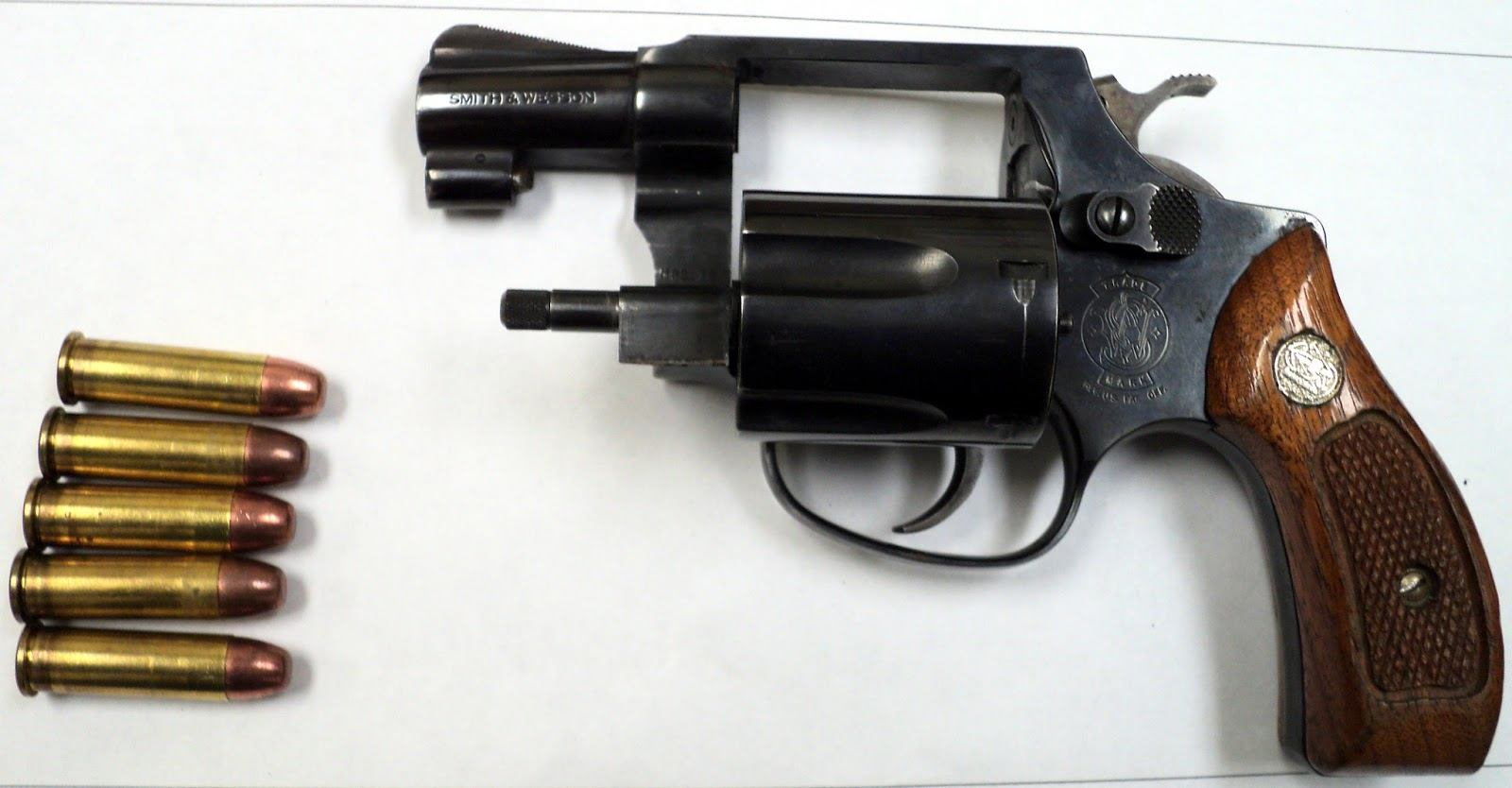 Loaded gun discovered in carry-on bag.