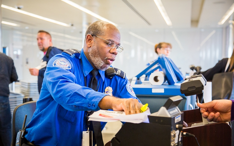 TSA Officer checks travel documents