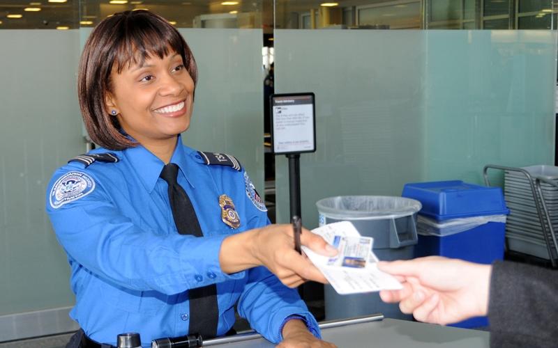 TSA officer checking passenger's ID.