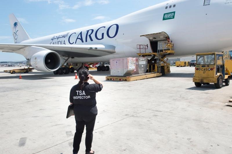 TSA Inspector approaching cargo plane.