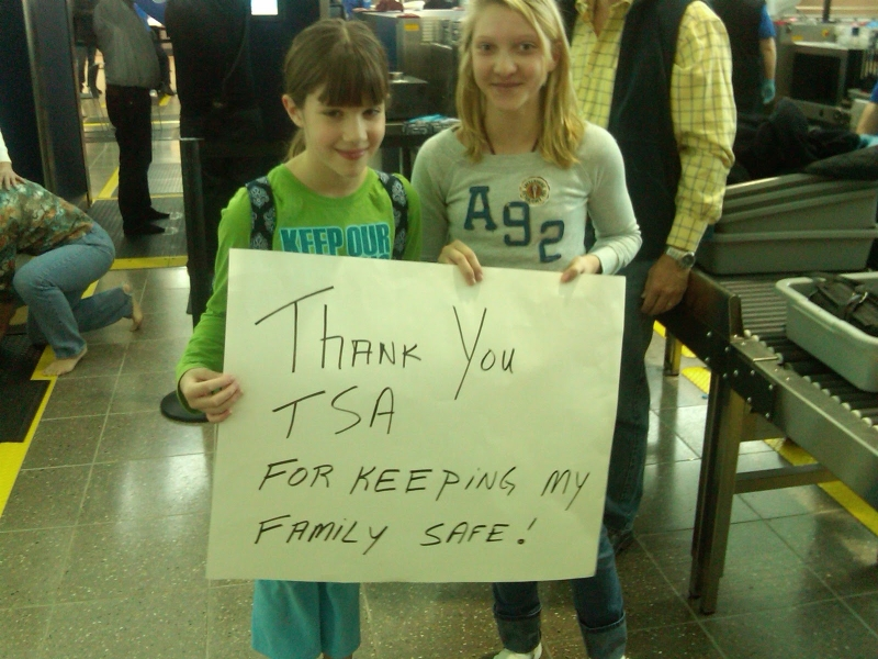 Children with thank you sign for TSA.