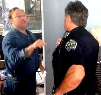 Alex Jones arguing with police officer.