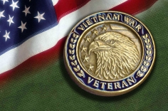 Vietnam War medal on U.S. flag background