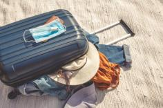 Carry-on bags with clothes and masks