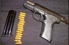 gun with bullets and clip