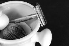 Shaving razor, brush, and mug.