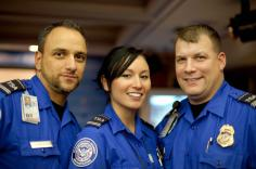 A photo of three Transportation Security Officers