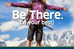"Female hiker in the mountains. ""Be there at your best. TSAprecheck"