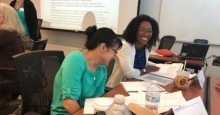 Crystal Daniel (right) and a course participant enjoy a light moment during Leadership Admist Change 2019 continuous learning class.
