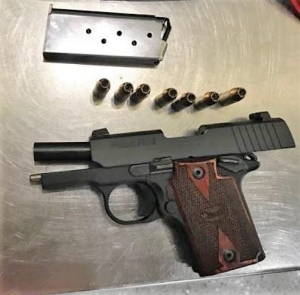 This loaded 9mm semi-automatic handgun was detected by TSA officers in a man's carry-on bag on at Boston Logan International Airport. (Photo courtesy of TSA.)