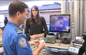 A Transportation Security Officer uses Credential Authentication Technology to verify identity during a demonstration (TSA Image).