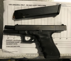 TSA officers prevented a man from bringing this loaded handgun onto an airplane on Christmas at Dulles Airport. (TSA photo)
