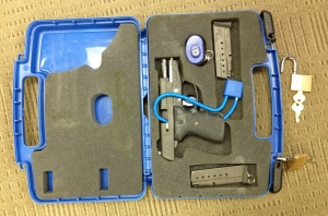 Firearm properly packed in blue case