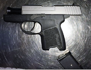 A Hamilton, Virginia, man was stopped by TSA officers at the IAD Airport checkpoint carrying this loaded semi-automatic handgun on Wednesday. (TSA photo)
