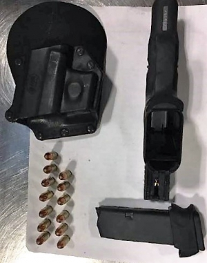TSA officers detected this handgun at one of the checkpoints at DCA on Wednesday. This angle shows the magazine clip removed from the bottom of the gun. (Photo courtesy of TSA.)