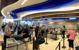 Travelers flying out of Greater Rochester International Airport pass through the newly redesigned four-lane checkpoint. (TSA photo)