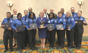 The TSA Miami International Airport Passenger Support Specialist Team was awarded the Federal Employee of the Year Organizational Partnership Award by the South Florida Federal Executive Board for their outstanding support of military veterans and the Wounded Warriors Program in Coral Springs, Fla., Wednesday, May 11, 2016.