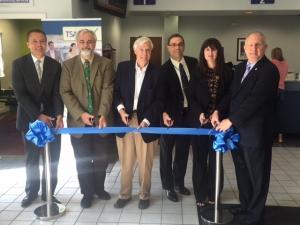 Officials cut the ribbon signifying the official opening of the TSA Pre✓®  application center inside the Fredericksburg DMV office. (TSA photo)