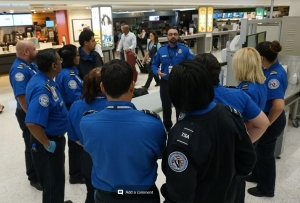 TSA officers from LaGuardia Airport get a briefing from a supervisor at George Bush International Airport in Houston. (Photo by Michael Bastianelli)