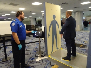 The enhanced Advanced Imaging Technology has a more open design that allows travelers to have a more relaxed stance with arms at their side during the scan instead of over their head. (TSA photo)