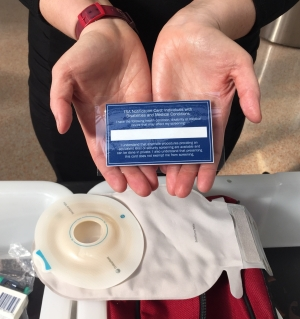 Travelers with a disability or medical condition can download a notification card from www.tsa.gov that they can show a TSA officer to discretely explain a medical condition so that the officer can properly screen the individual based on that information. Use of the card does not allow individuals to bypass screening. (TSA photo).