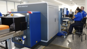 TSA is testing a computed tomography (CT) scanner to screen passengers' carry-on luggage. The unit, which creates a 3-D image of the contents of the bag, (TSA Photo)