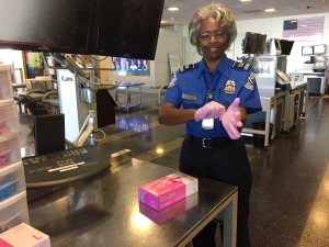 Supervisory TSA Officer pulls on pink gloves at a DCA Airport checkpoint on Monday morning, Oct. 3rd.