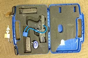 This is the proper way to fly with a firearm—unloaded inside a hard-sided, locked case that travels inside a piece of checked luggage. (TSA photo)