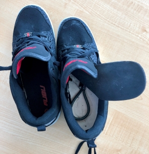 This is a pair of shoes with explosives concealed inside. They are used as training aids for TSA officers. TSA requires travelers remove their shoes to ensure that there is nothing concealed inside. (TSA photo)