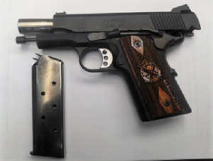 TSA officers detected this loaded .45 caliber handgun at one of the checkpoints at DCA on Monday, August 6th in the carry-on bag of a Springfield, Virginia, man. (Photo courtesy of TSA.)