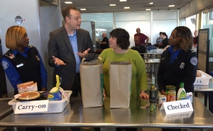 TSA officials discuss which food items can and cannot come through a checkpoint. (TSA photo)