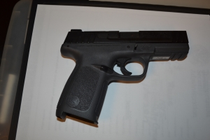 A loaded Smith and Wesson .40 caliber pistol was discovered hidden inside a passenger's wheelchair cushion.