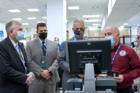 Viewing Credential Authentication Technology (CAT 1) are   Tim Lewis, Deputy Federal Security Director;  Adam Ostrowsky, Assistant Federal Security Director- Screening;  Congressman Mario Diaz-Balart; and  Eduardo Lopez, TSA Expert Security Training Instructor.