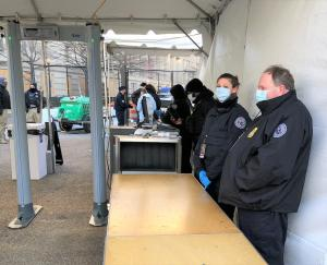 TSA officers Sarita Mason of Plattsburgh International Airport and Frank Scott of Greater Binghamton Airport wait for someone to come to the checkpoint to be screened on Inauguration Day. (TSA photo)